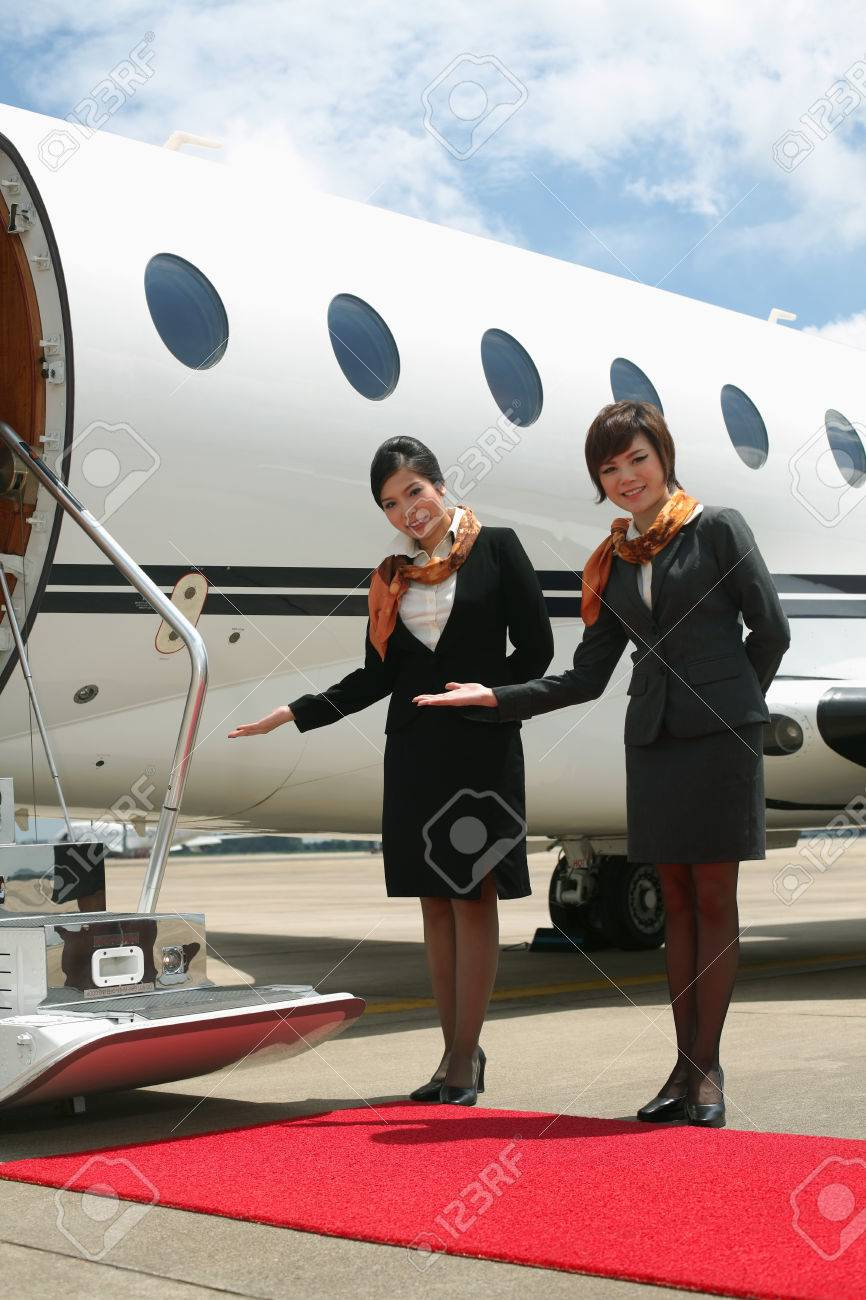Flight Attendants Standing By Private Jet Stock Photo, Picture And ...