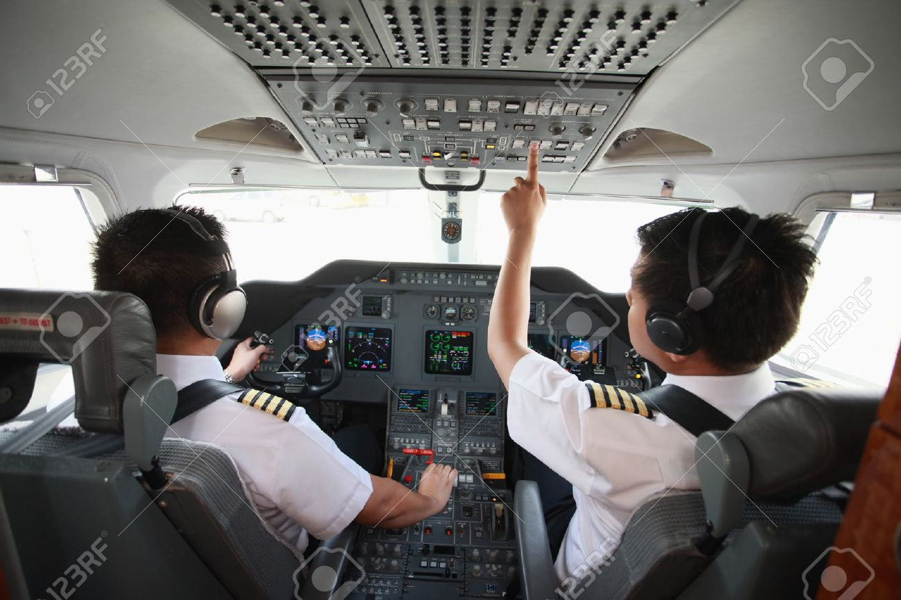Pilot and co-pilot in private jet cockpit Stock Photo - 26386309