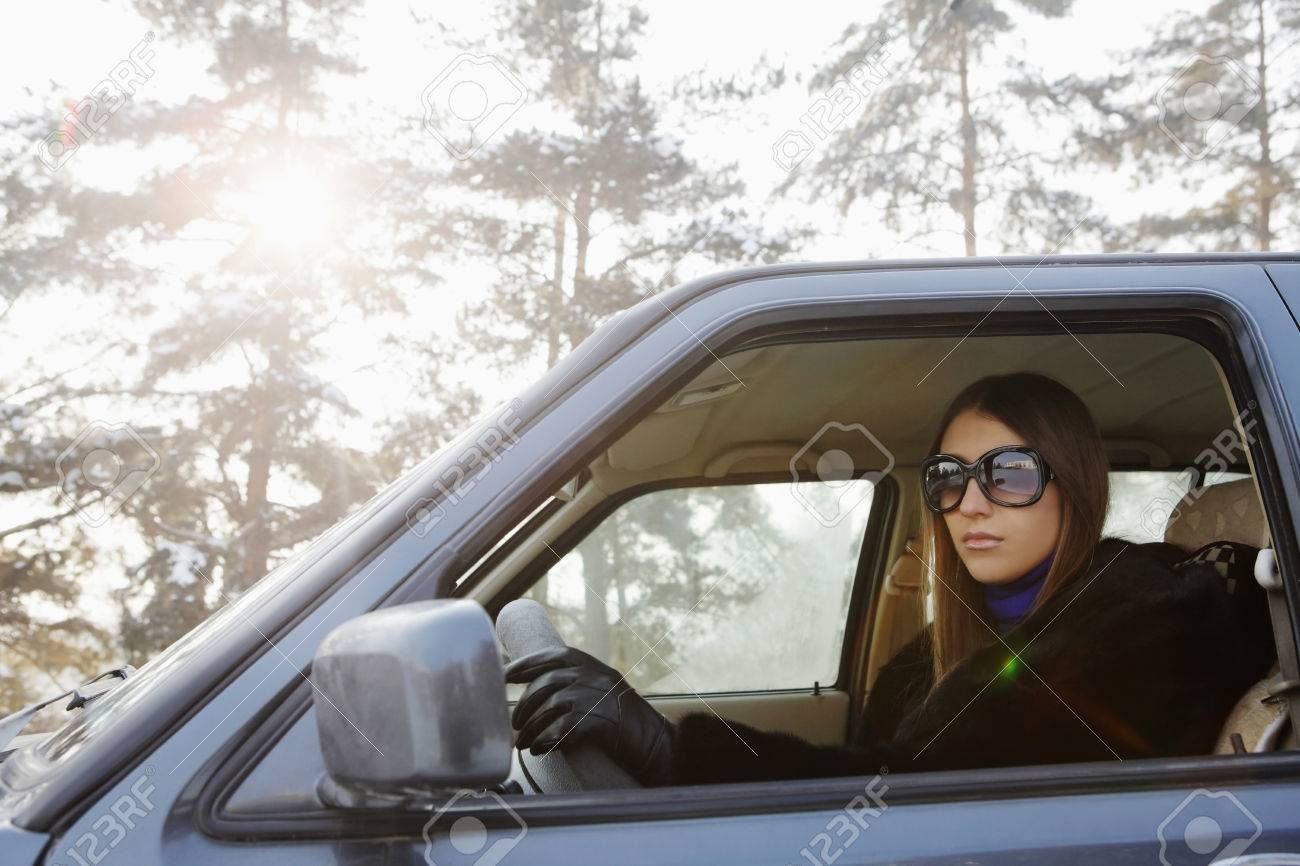 Driving gloves girl - Businesswoman Driving On Winter Day Stock Photo 26388598