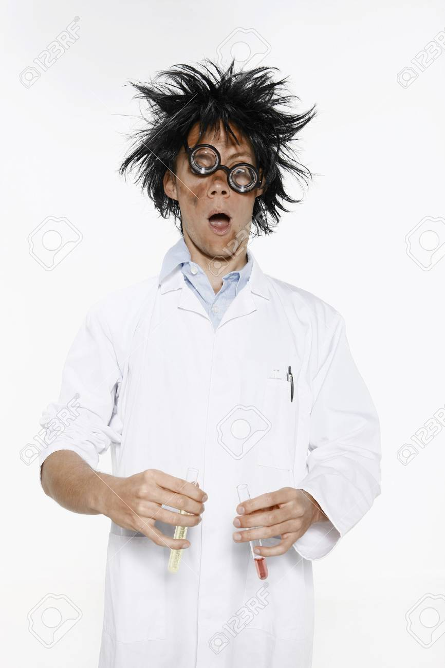 Man with hair and face in a mess holding test tubes of liquid Stock Photo - 26391016