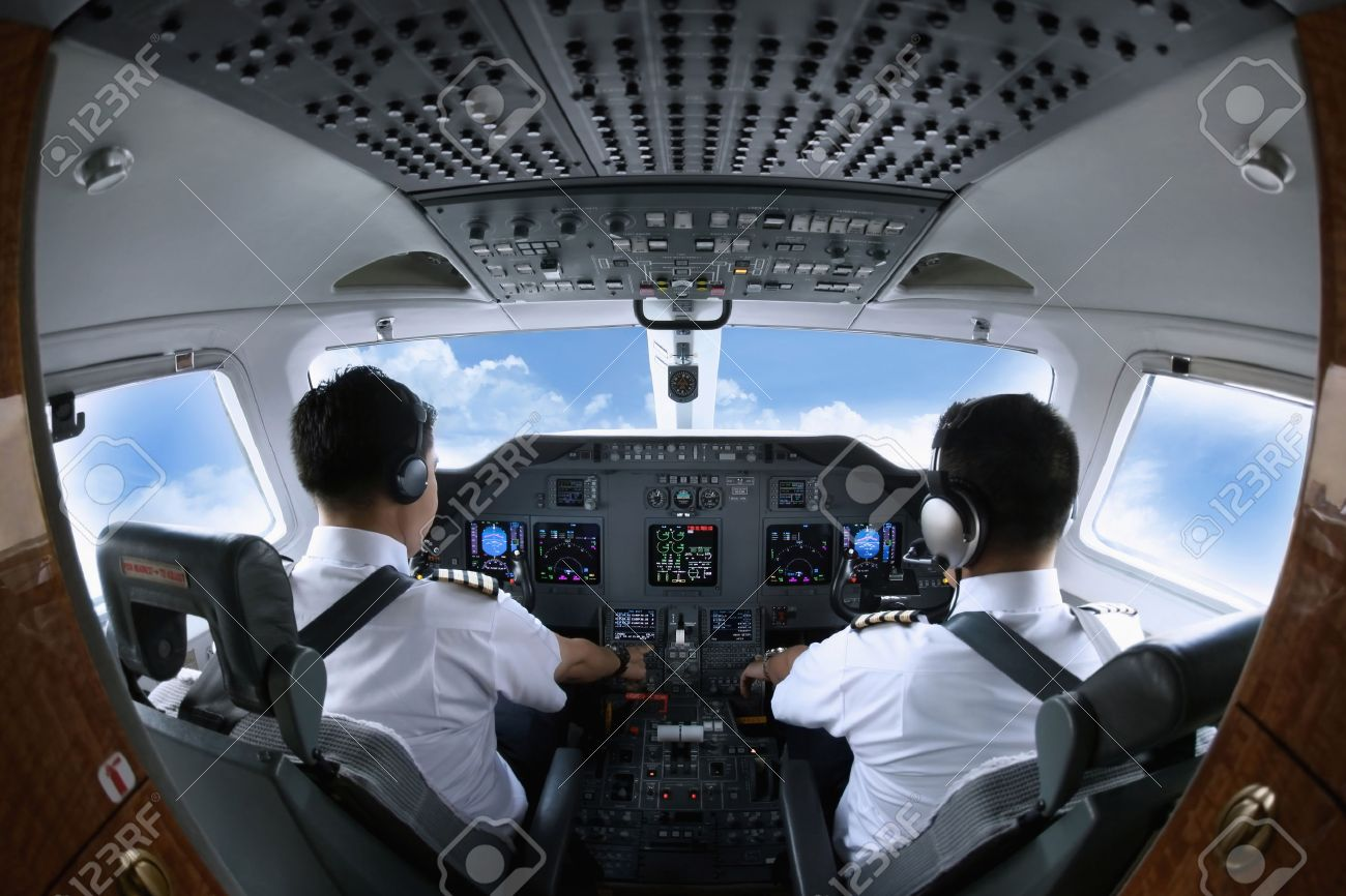 Pilot and co-pilot in private jet cockpit Stock Photo - 26391543