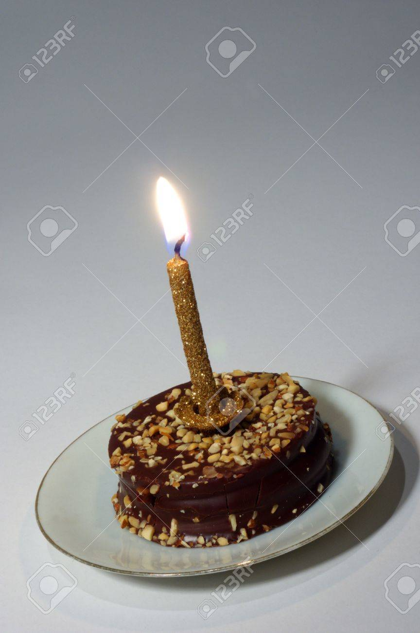 Very Small Birthday Cake With A Golden Candle Stock Photo, Picture ...