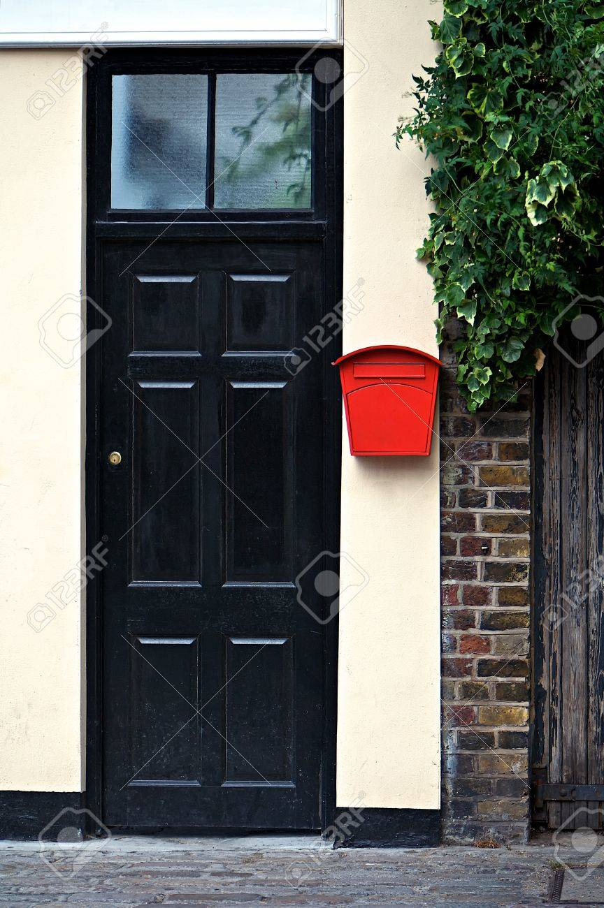 Black door front with red letter box Stock Photo - 12112680