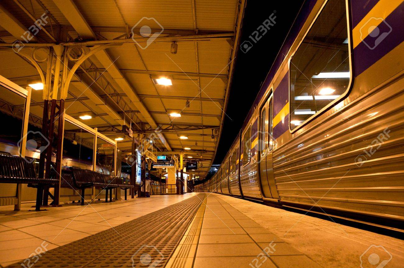 Train Stopped at train station at night - 16425504