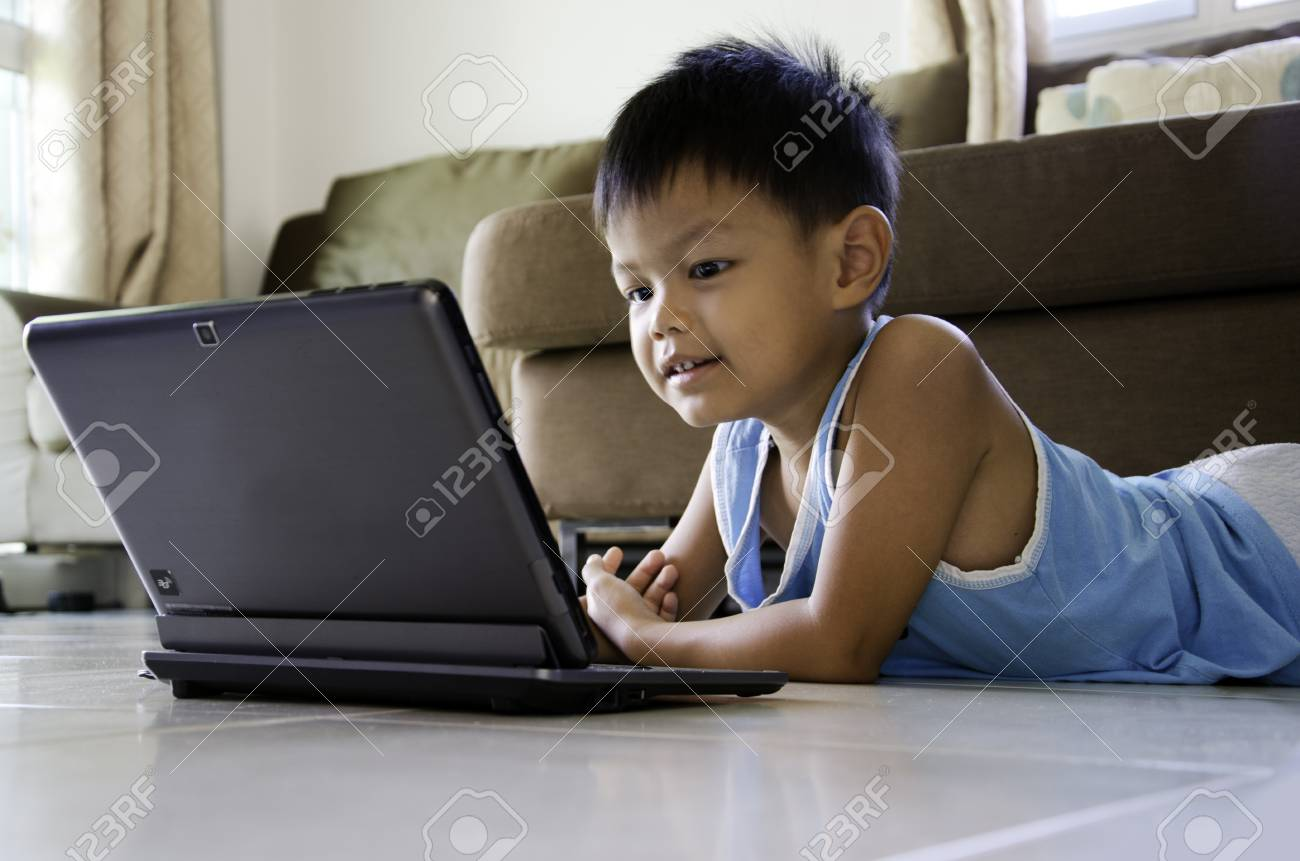 Kids having fun with a laptop Stock Photo - 20360460