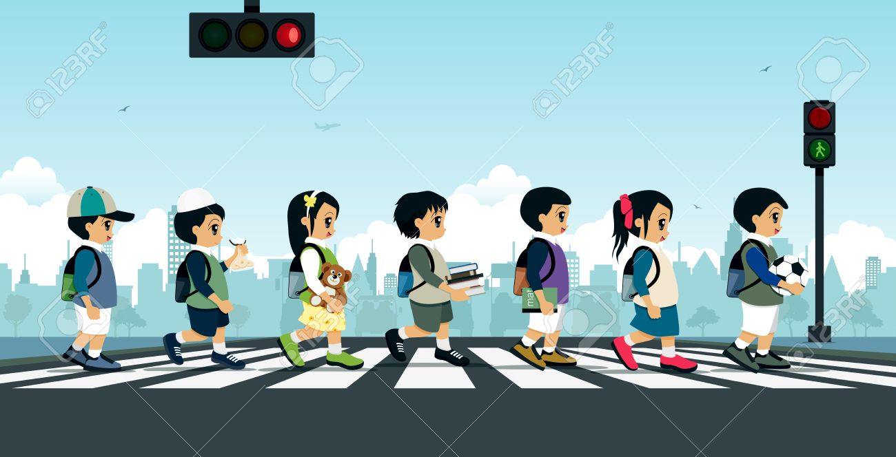 Students walking on a crosswalk with a traffic light. - 53446569
