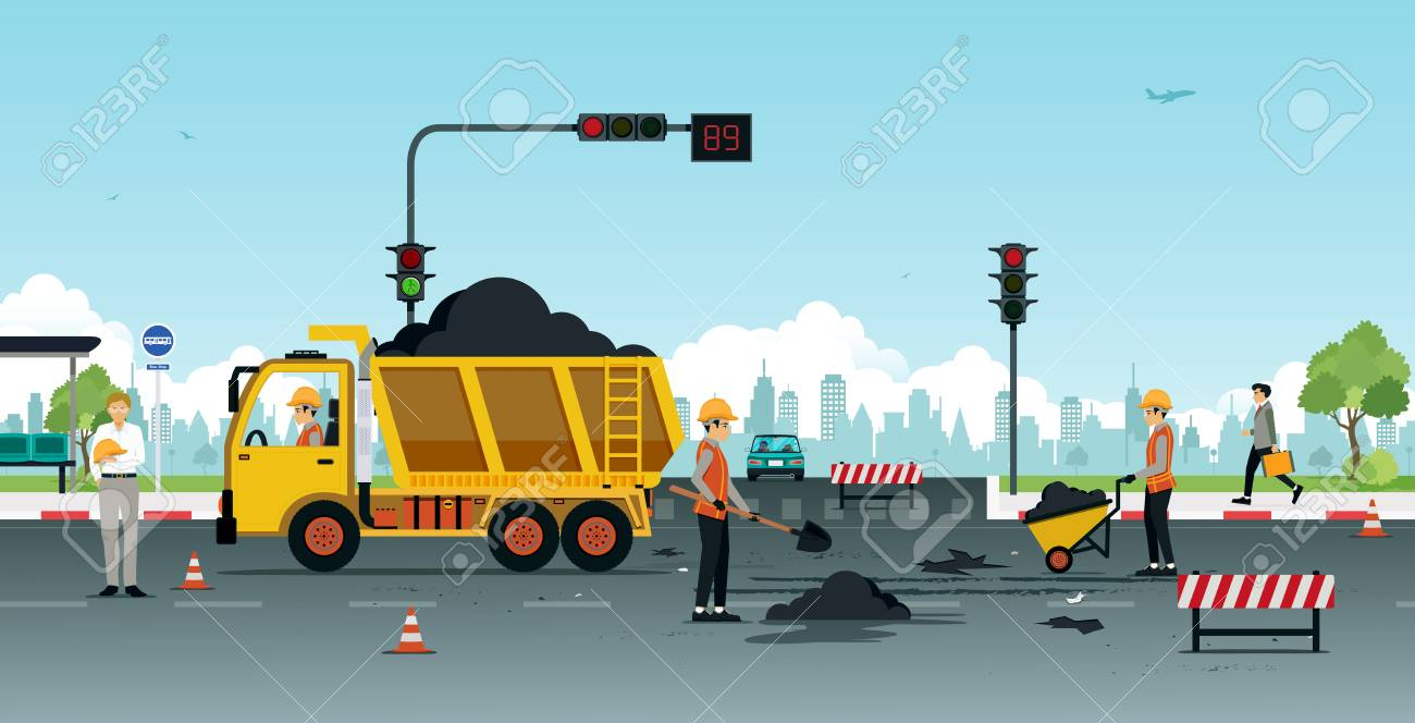 Workers are repairing road surfaces with traffic lights. - 93811780