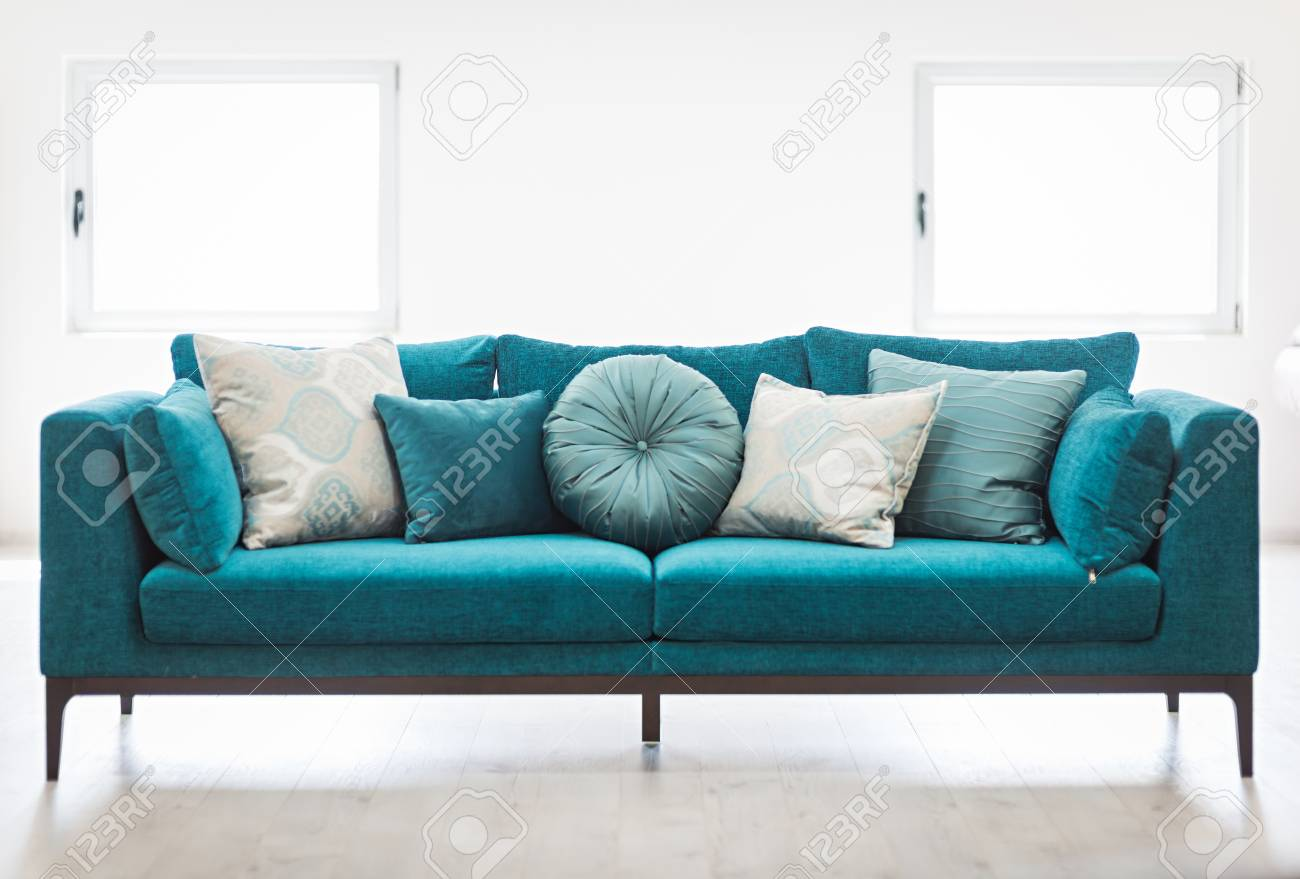 Bright Living Room Interior With Blue Sofa And Cushions Stock Photo Picture And Royalty Free Image Image 104785240