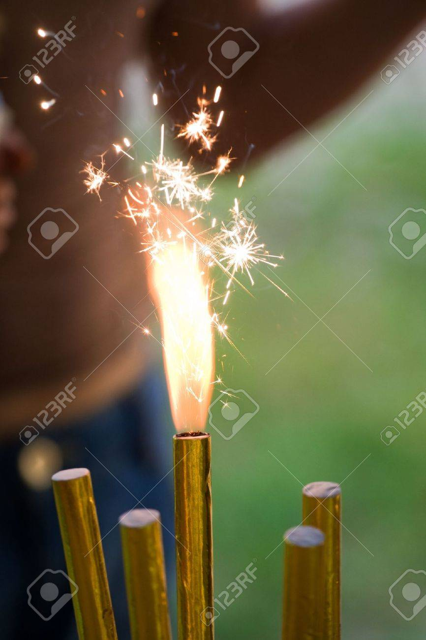 Five Birthday Cake Sparklers One Burning Stock Photo