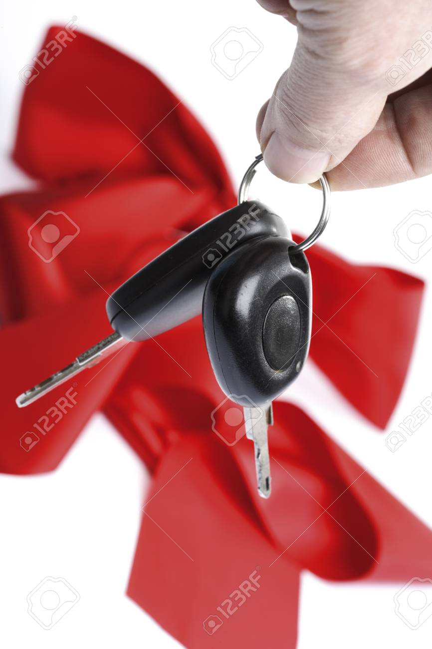 Man holding car keys, close-up Stock Photo - 23584288