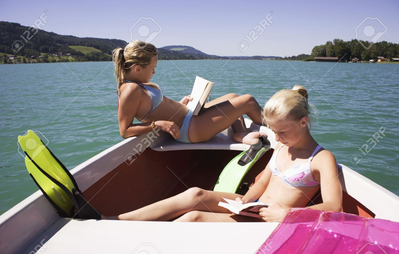 Worksheet Reading Boat girls 13 15 sitting on boat reading side view stock photo photo