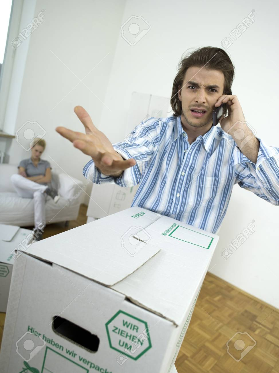 Man argueing at mobile phone Stock Photo - 23853246