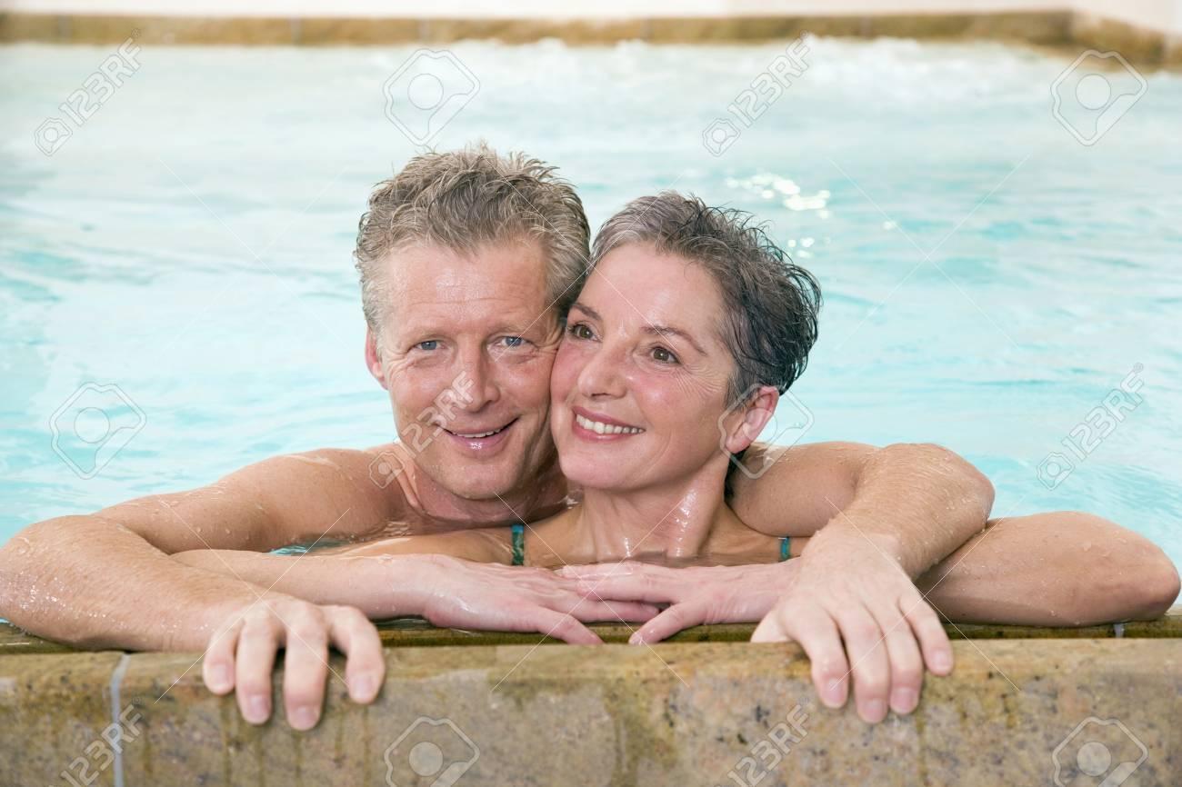 Mature couple embracing in swimmingpool, portrait Stock Photo - 23891362