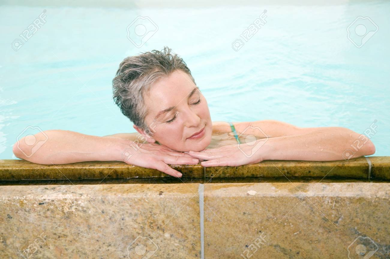 Mature woman in swimmingpool, portrait Stock Photo - 23891363