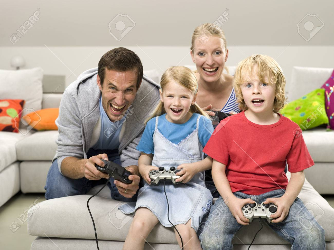 Family playing compouter game Stock Photo - 24303137