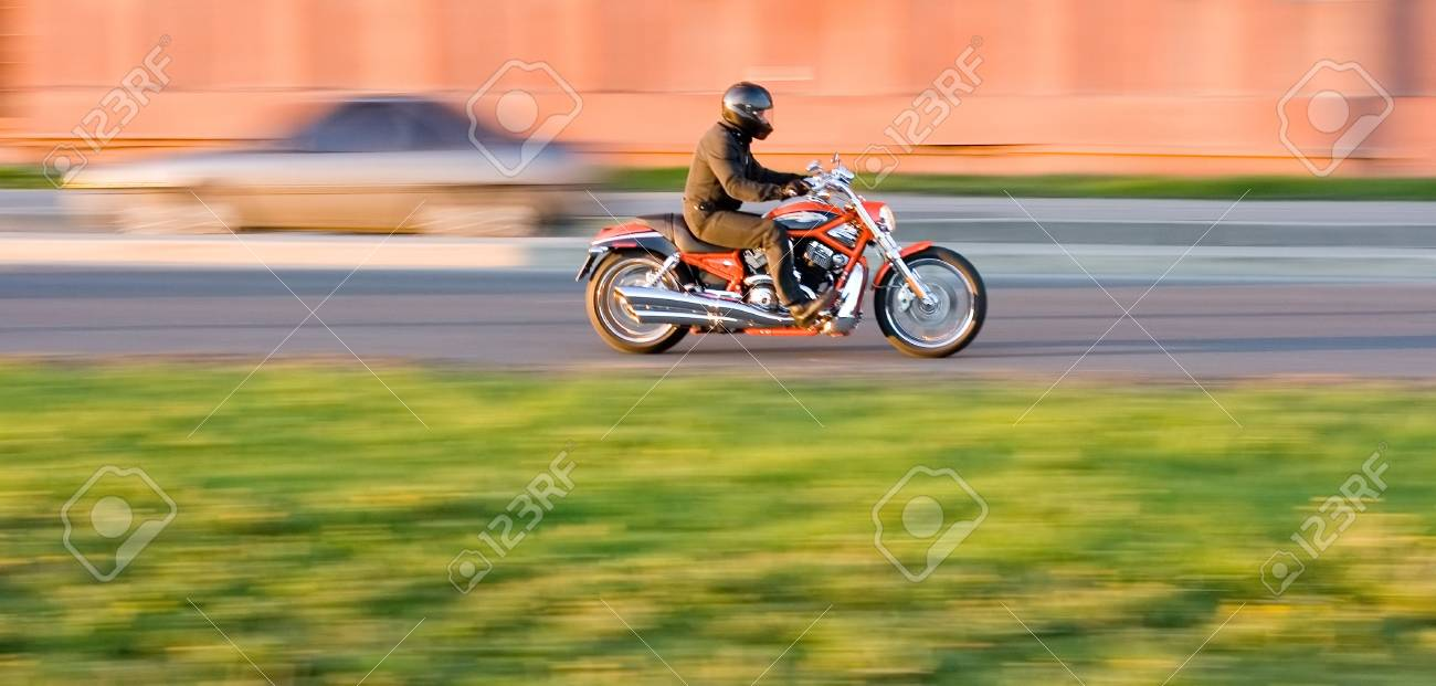man enjoying a motorcycle ride in the city Stock Photo - 2596458