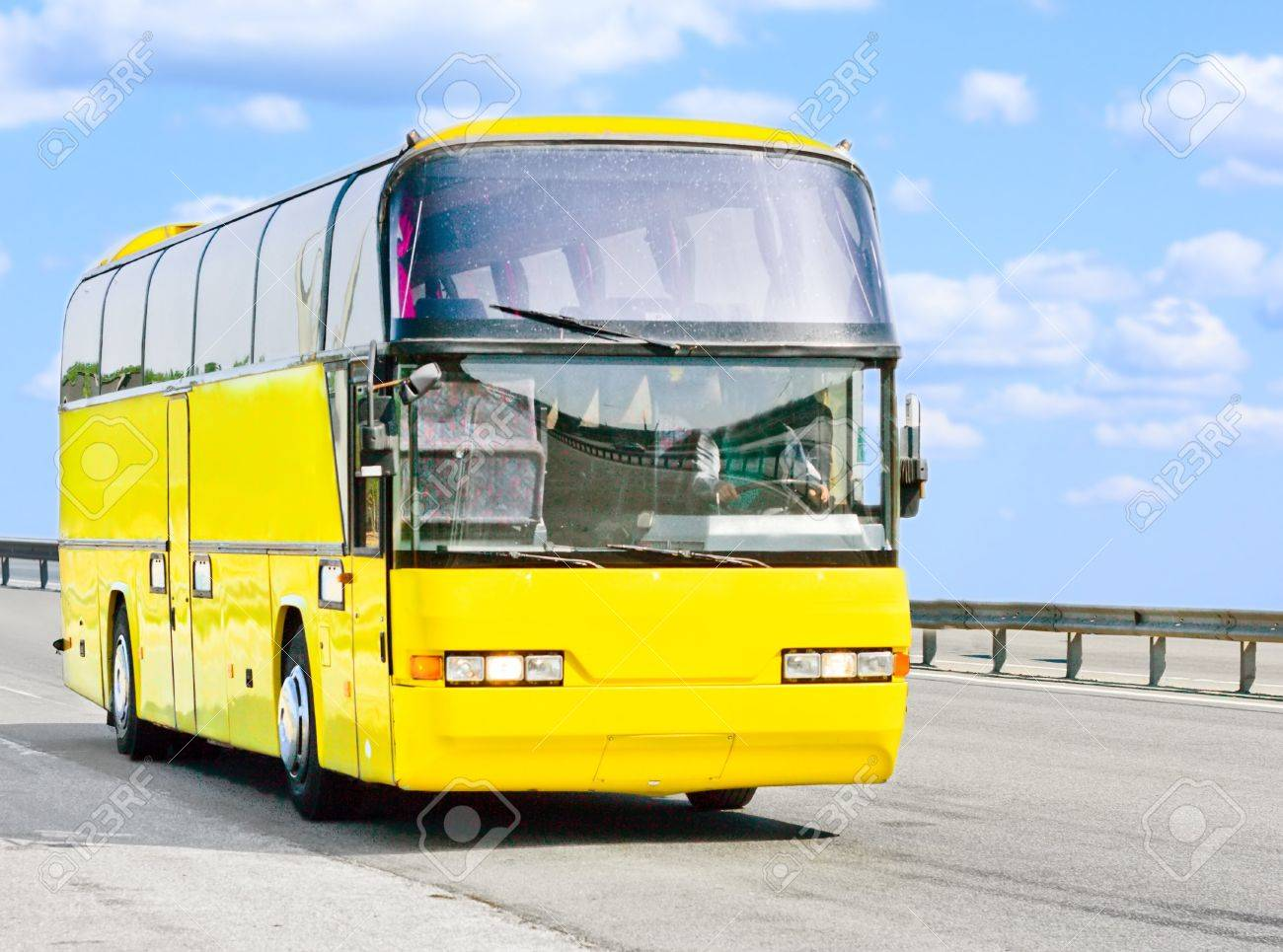yellow bus on a sunny road Stock Photo - 4571135