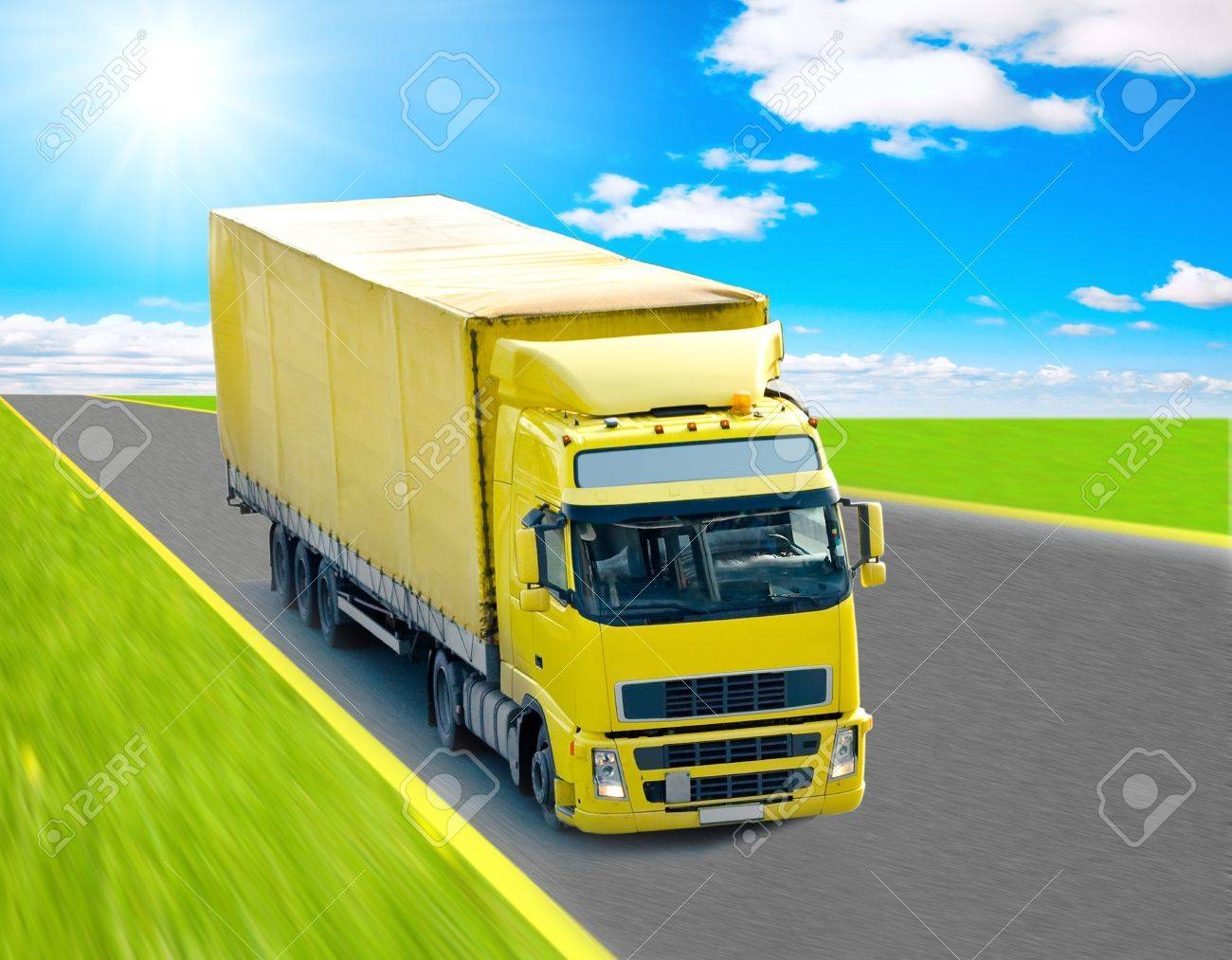 Yellow truck on a highway Stock Photo - 10078035