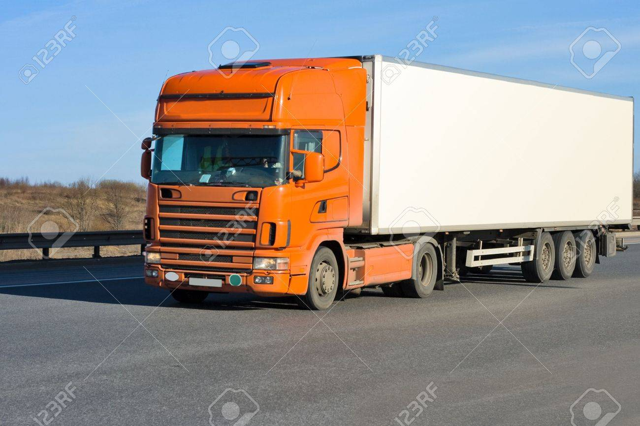 orange truck with white container on road Stock Photo - 10076411