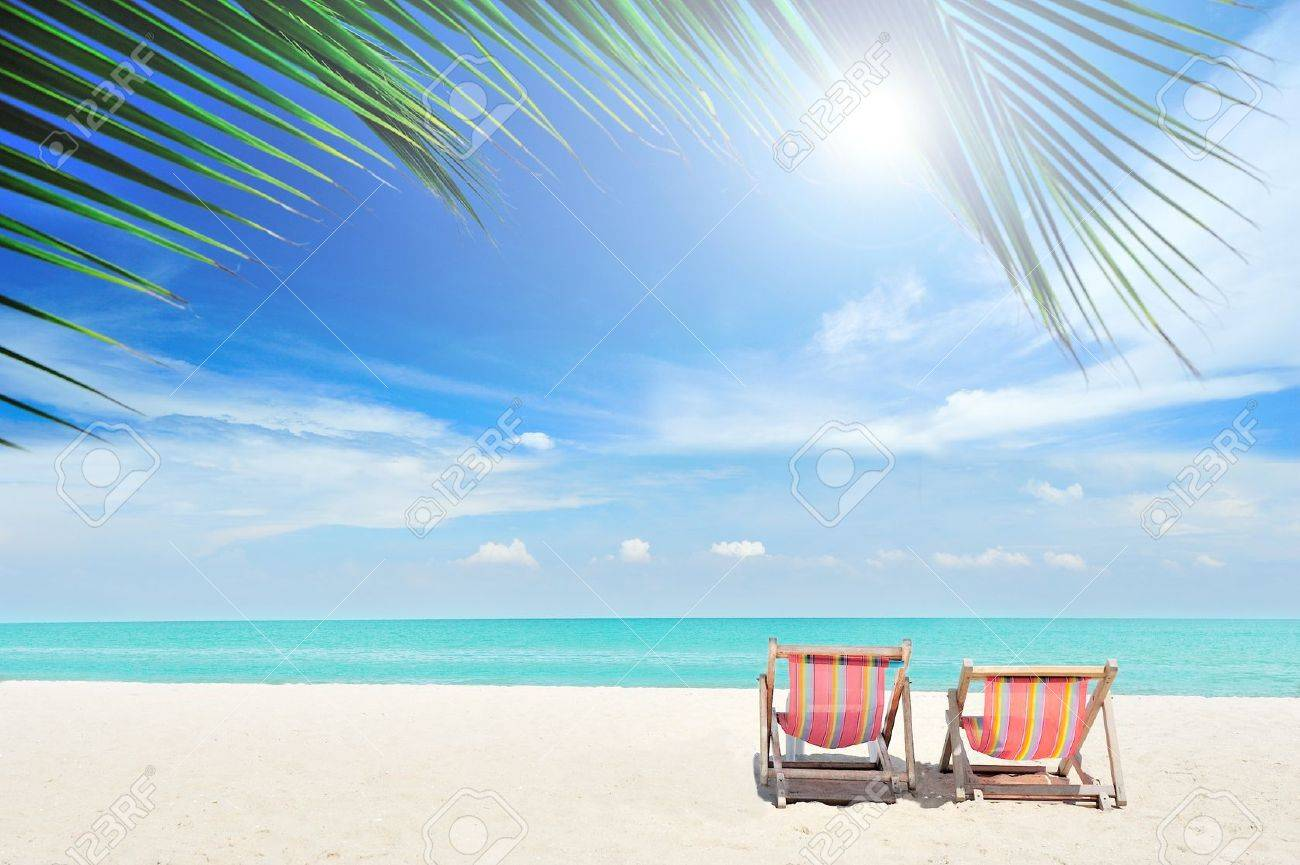 Beach with chairs - Beach Chairs On The White Sand Beach With Cloudy Blue Sky Stock Photo 13056328
