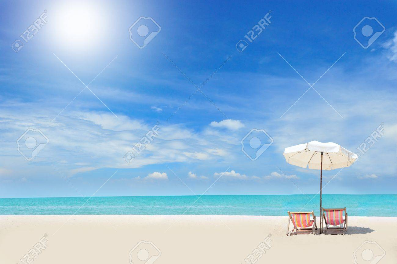Beach with chairs - Beach Chair Beach Chairs On The White Sand Beach With Cloudy Blue Sky Stock Photo