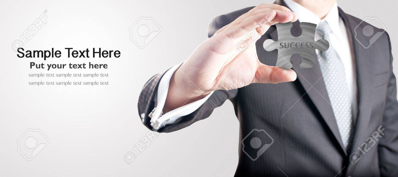 Business man showing metal jigsaw puzzle piece with  SUCCESS  wording  Concept for business strength and success Stock Photo - 14182976