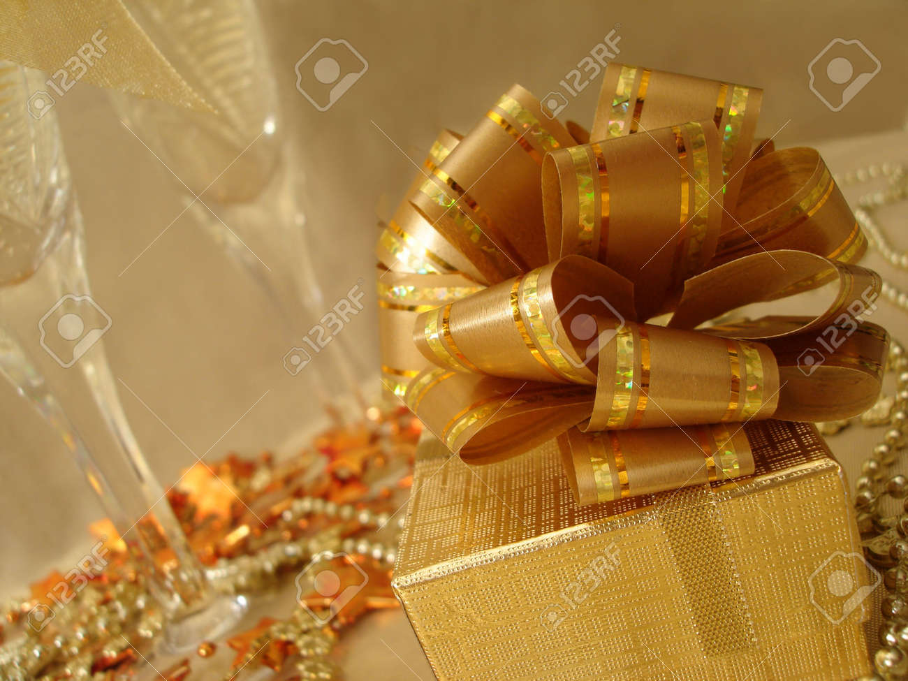 golden gift box on a beautiful background with champagne glasses Stock Photo - 763802
