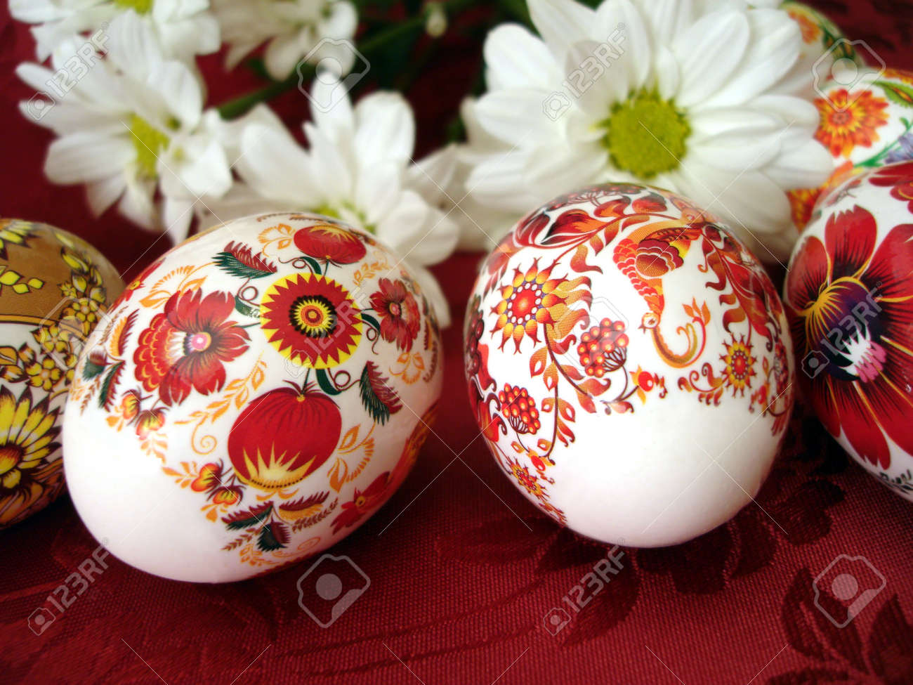 beautiful red easter eggs with white flowers stock photo picture