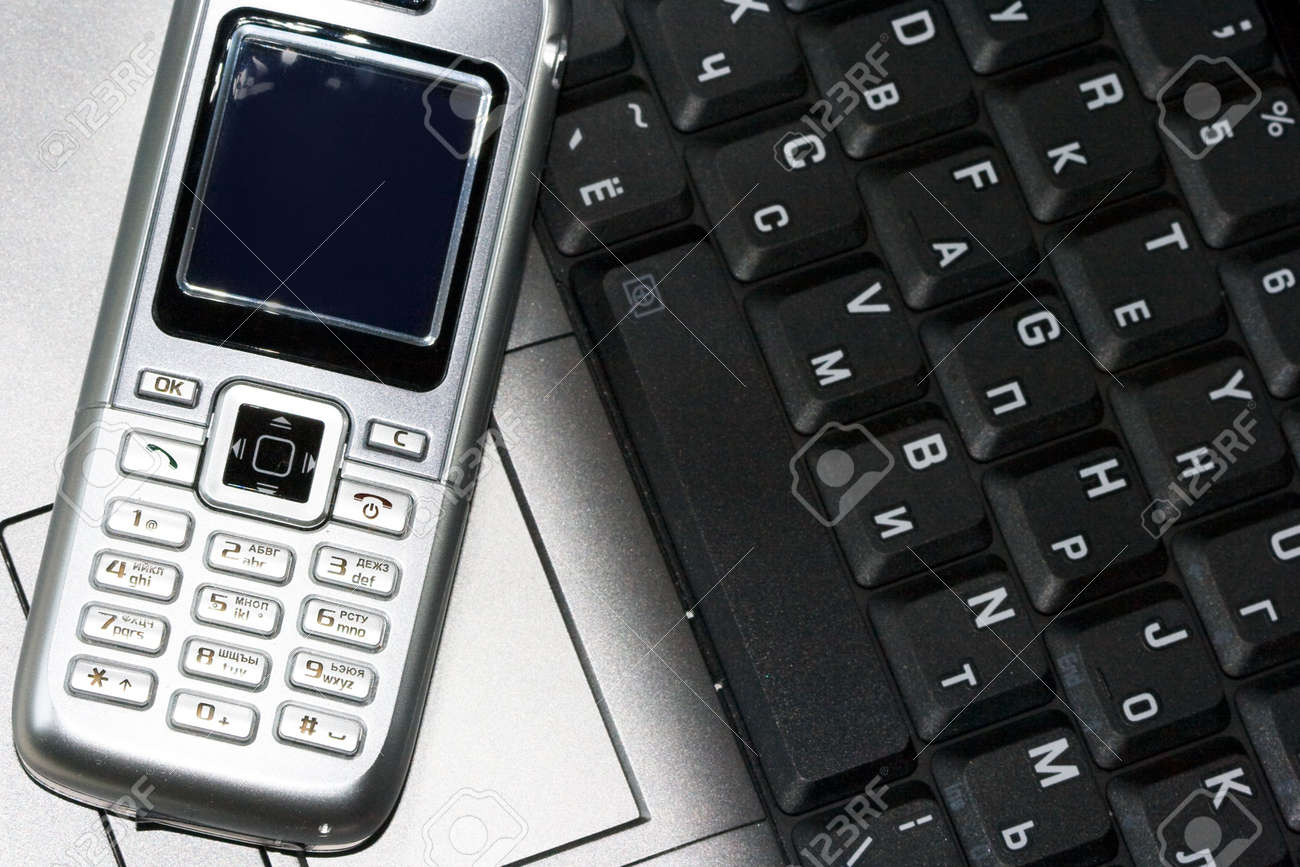 Mobile phone and computer keyboard (business conception) Stock Photo - 3916697
