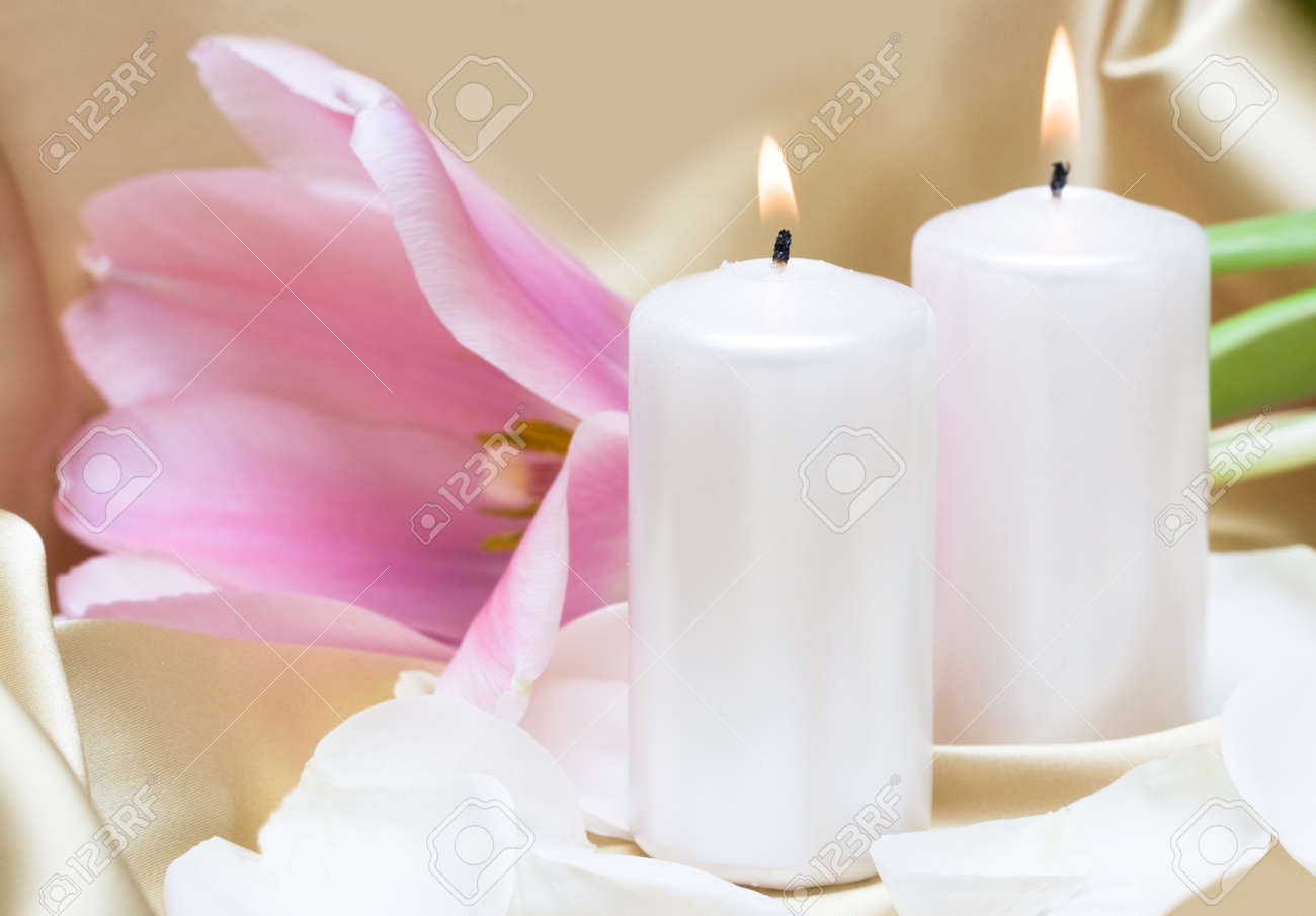 Candles with flower on golden background Stock Photo - 4266401