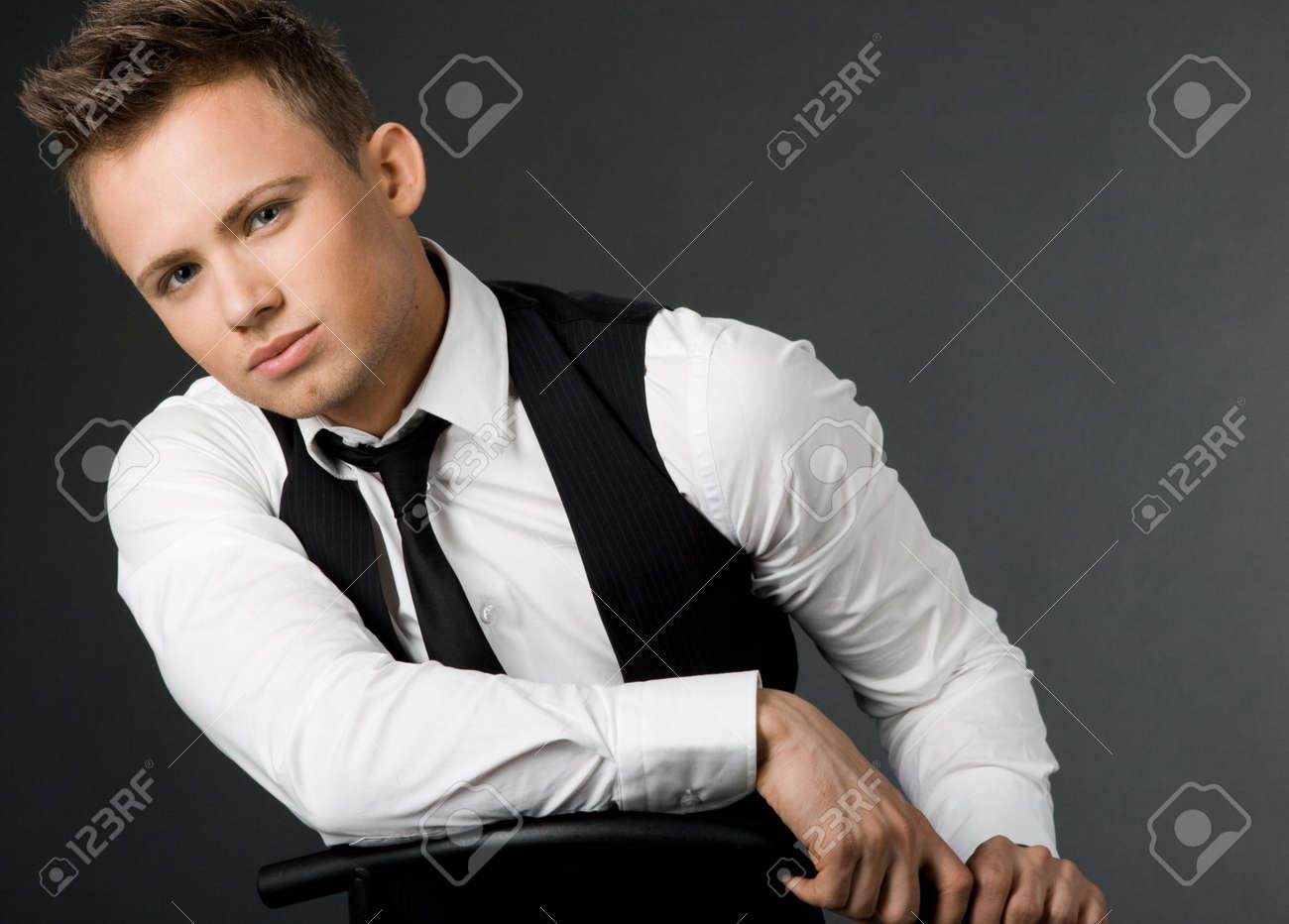 attractive businessman in black waistcoat Stock Photo - 5263133