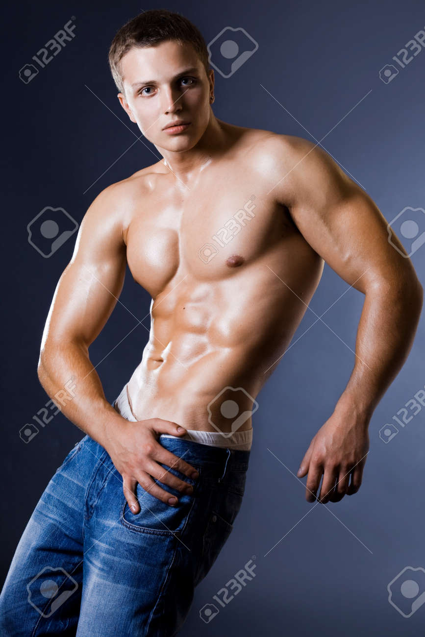 young bodybuilder man on black background Stock Photo - 8263456