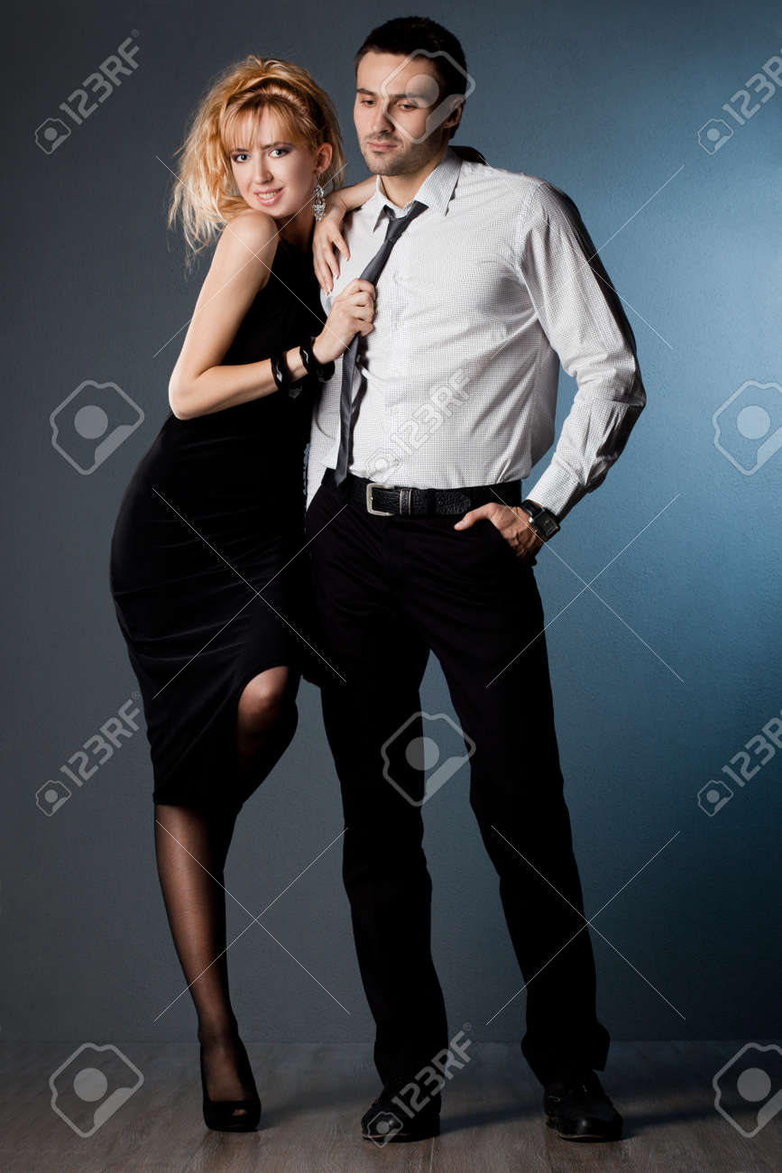 couple - girl and guy near the wall Stock Photo - 8393155