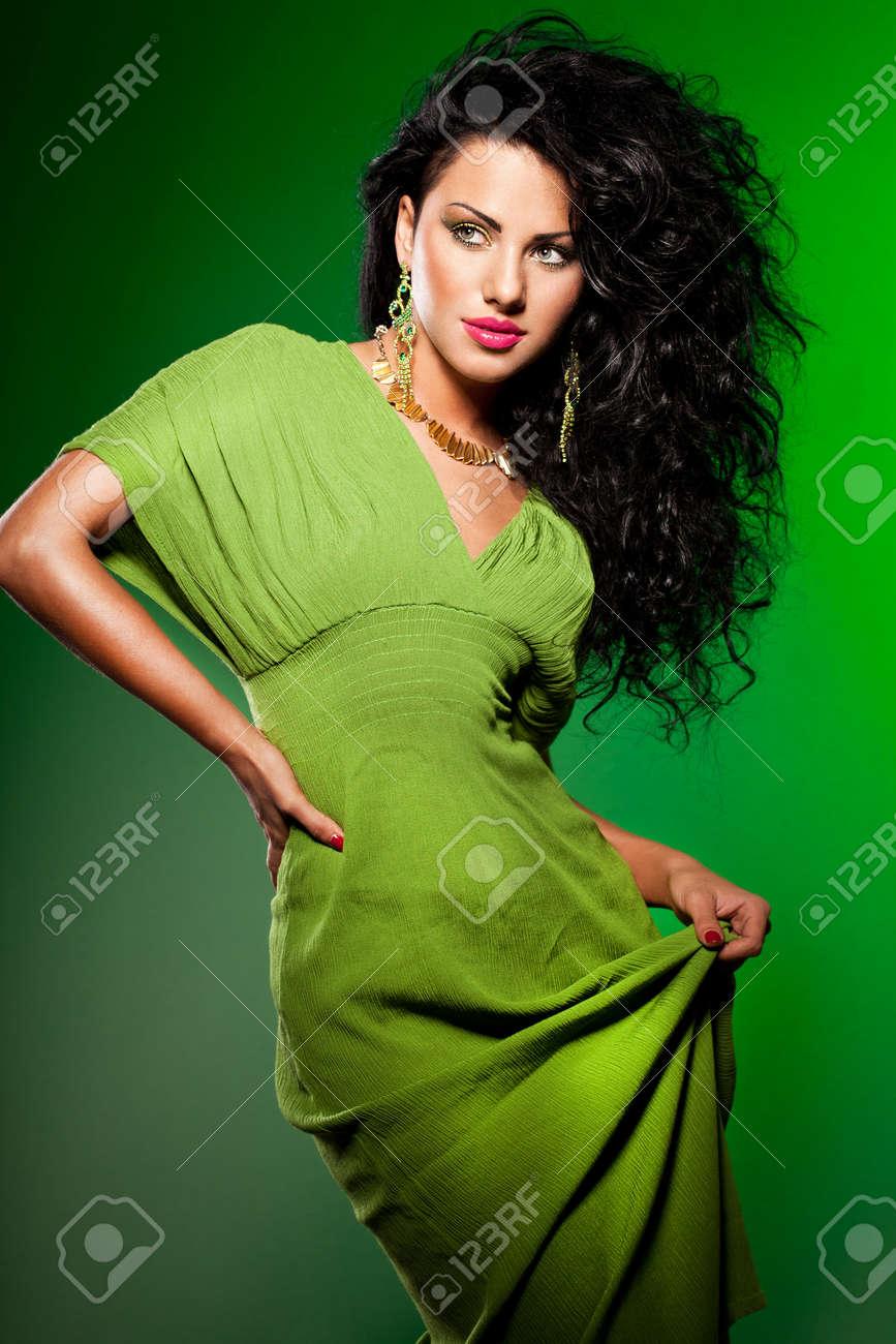 elegant fashionable woman on green Stock Photo - 9110791