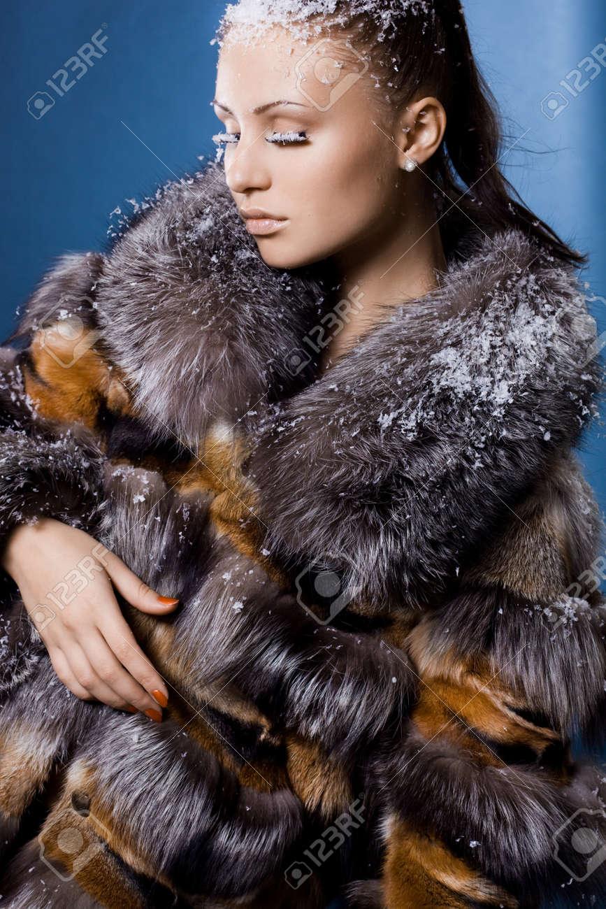 beautiful woman in a fur coat Stock Photo - 12015041