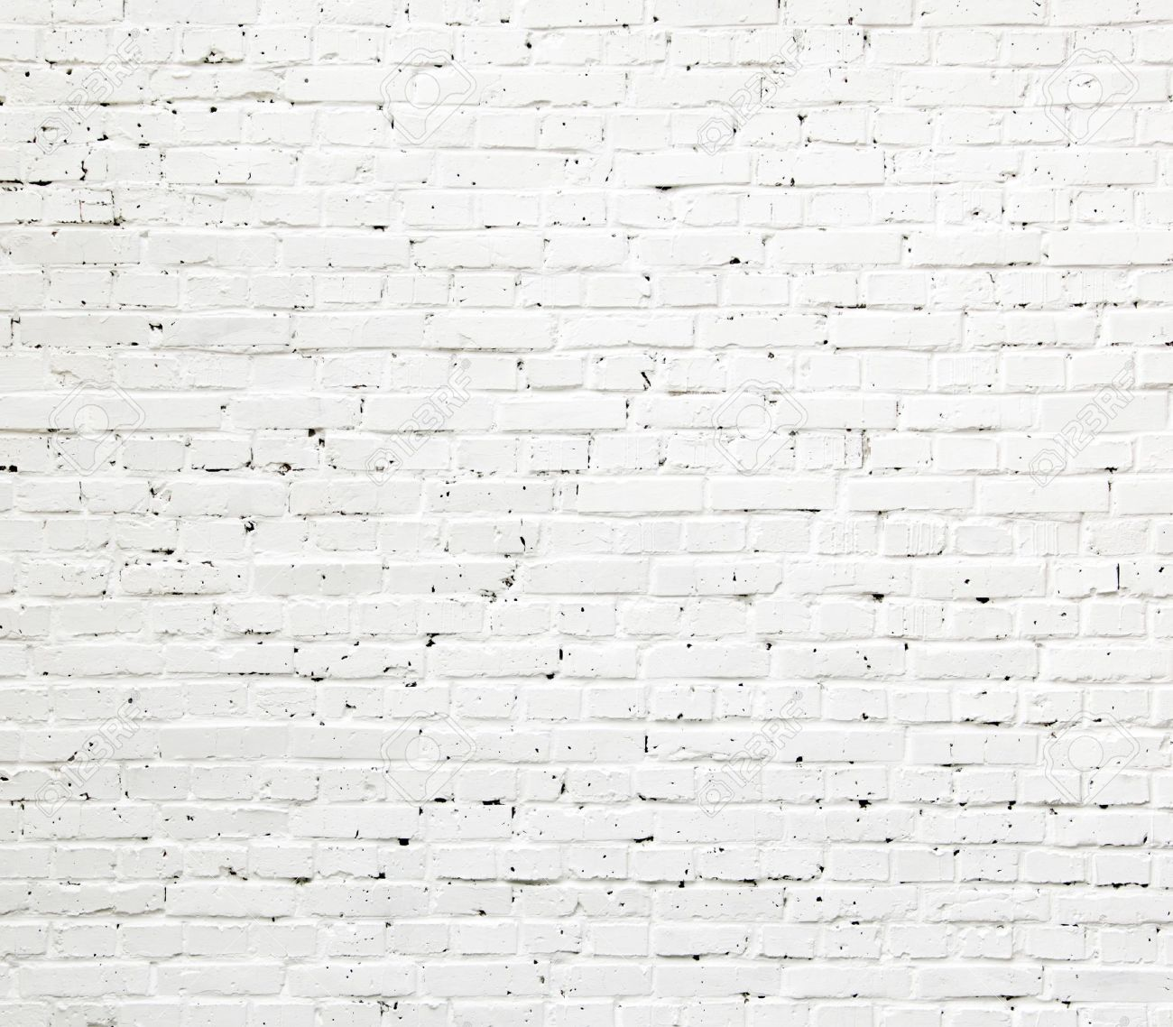 A White Roughly Textured Brick Wall Painted With White Paint Stock