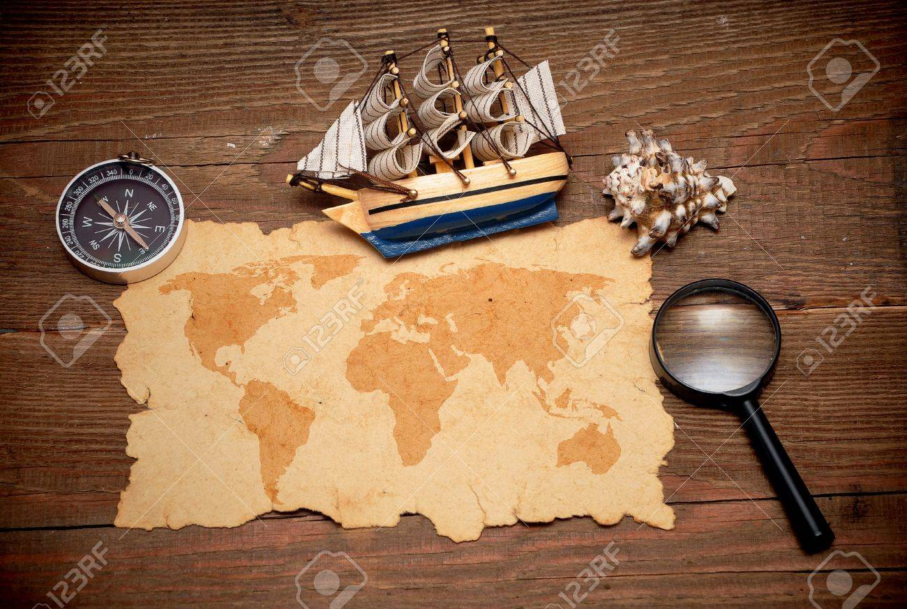 model classic boat, compass and loupe on wood background Stock Photo - 8610712