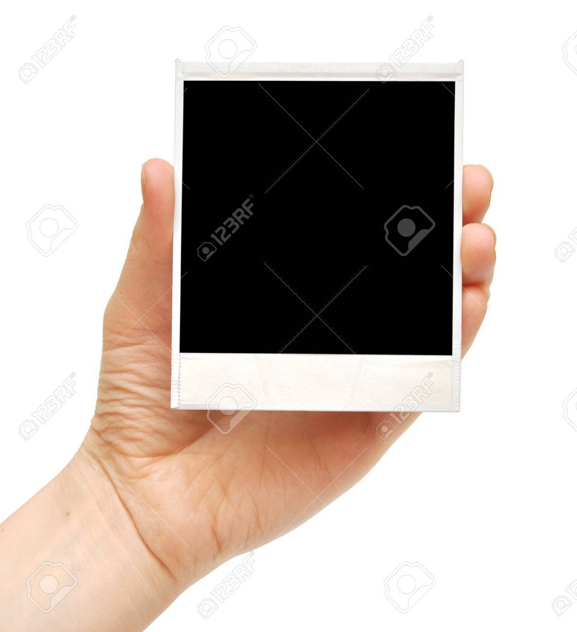 one instant photo in hand isolated on white background Stock Photo - 8889764