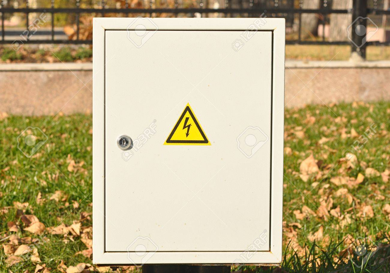 Fuse box with black/yellow sign warning for risk of electrocution Yellow On Fuse Box on