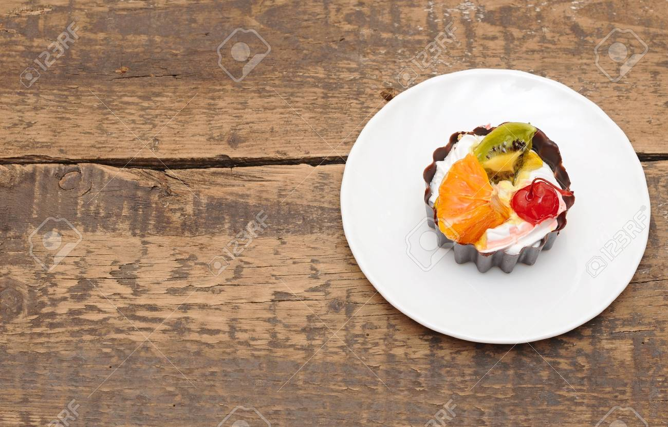 fresh baked cupcake closeup on a wooden table Stock Photo - 13628509