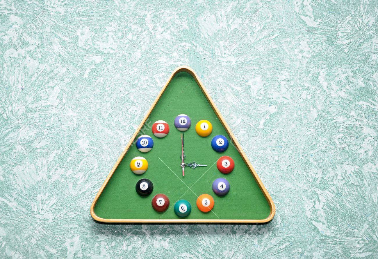 stock photo wall clock in snooker hall in triangle frame shape