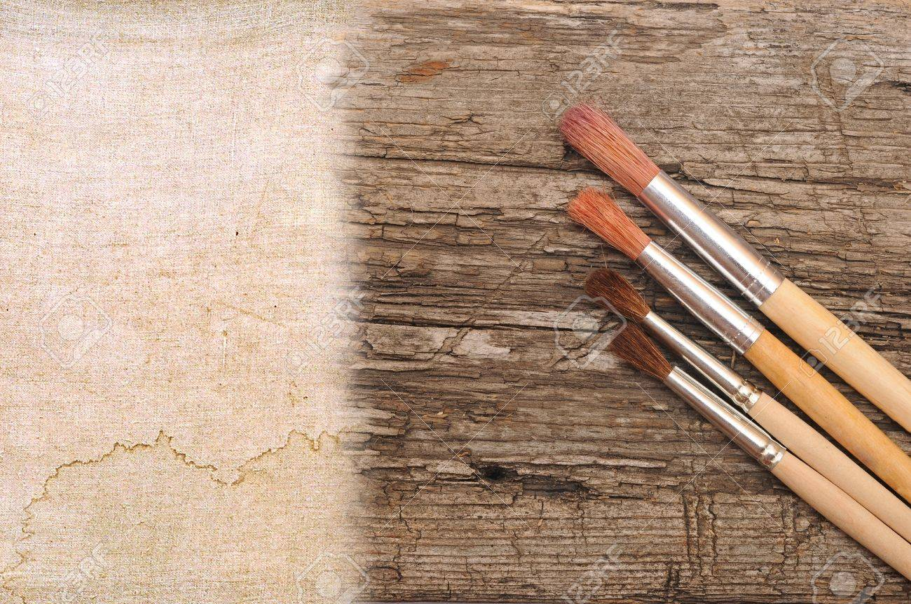 art paint brush on wood and canvas with space for text or image Stock Photo - 15778881