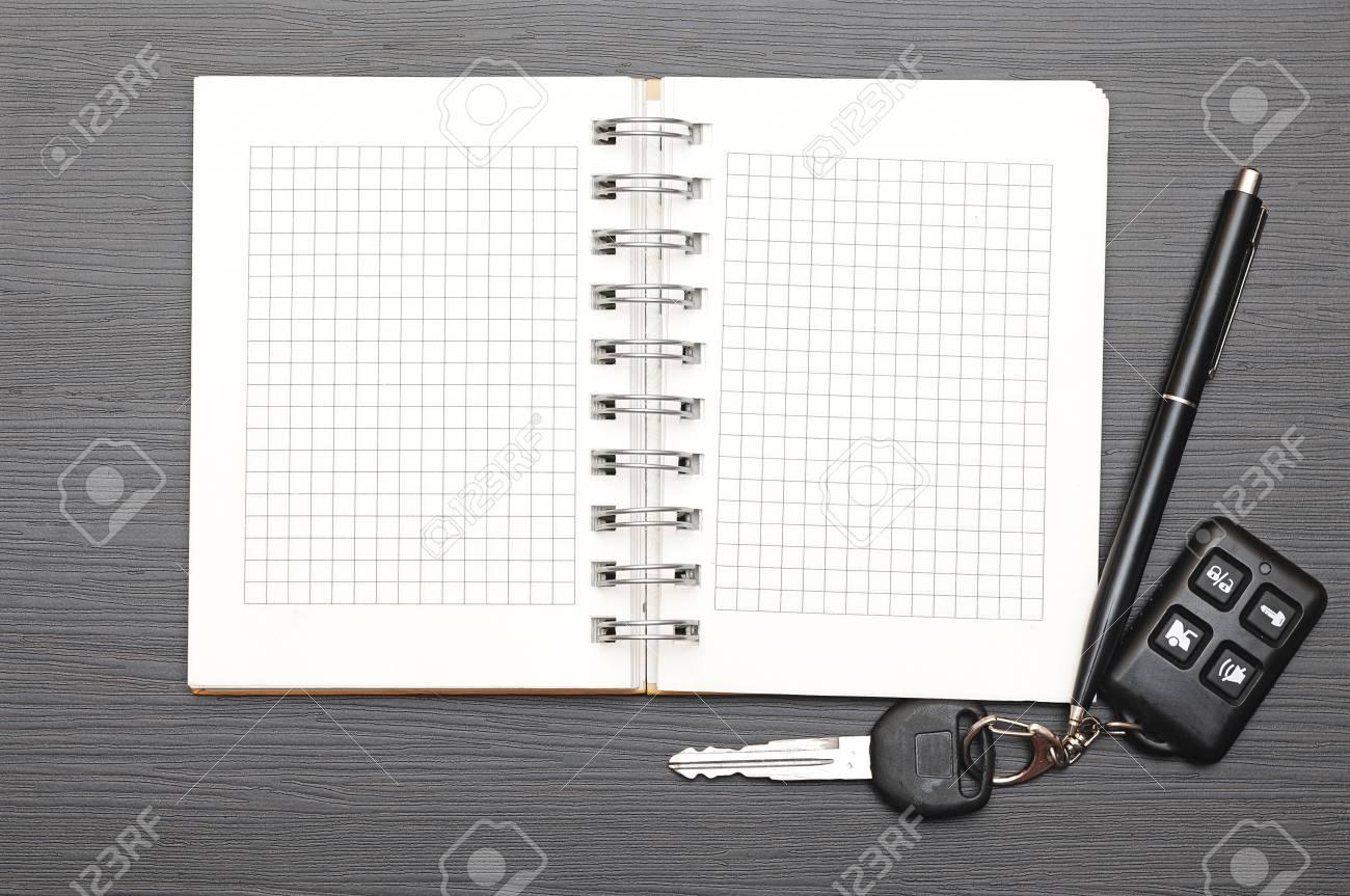 Keys on notepad on dark wooden background Stock Photo - 15858887