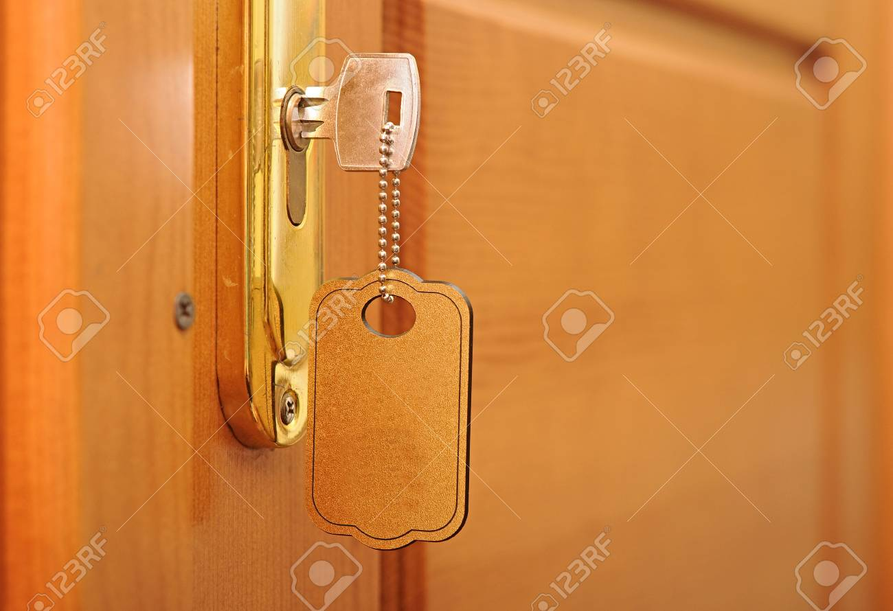 key in keyhole with blank label Stock Photo - 18496317