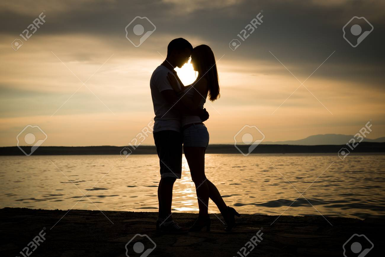 Couple In Love Silhouette Shadow Holding Kissing Seaside Stock Photo Picture And Royalty Free Image Image 83436037