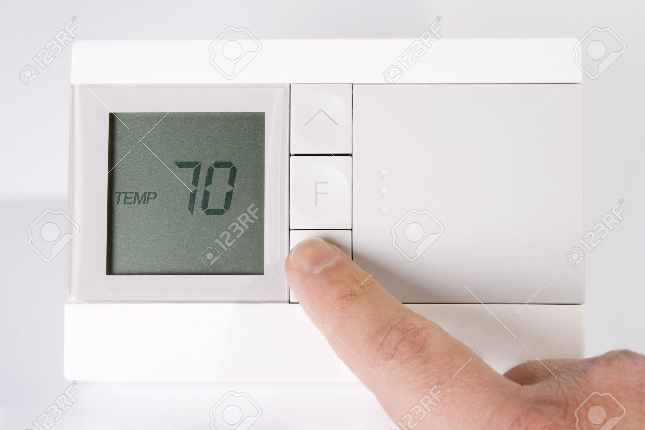 Stock image of hand adjusting thermostat Stock Photo - 6480706