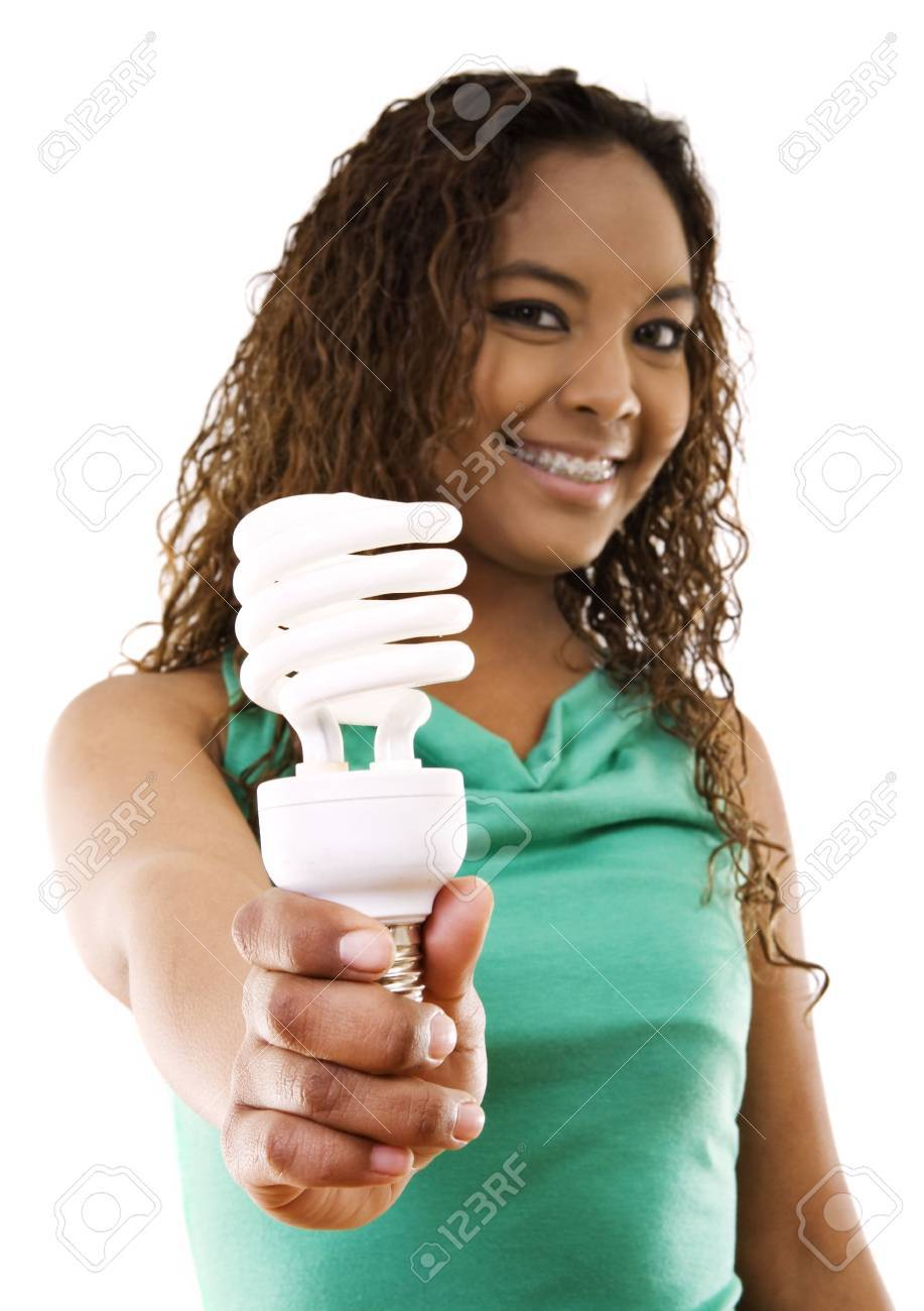 Stock image of girl holding an energy saving compact flourescent light bulb over white background, selective focus on hand and light bulb. Stock Photo - 6635699