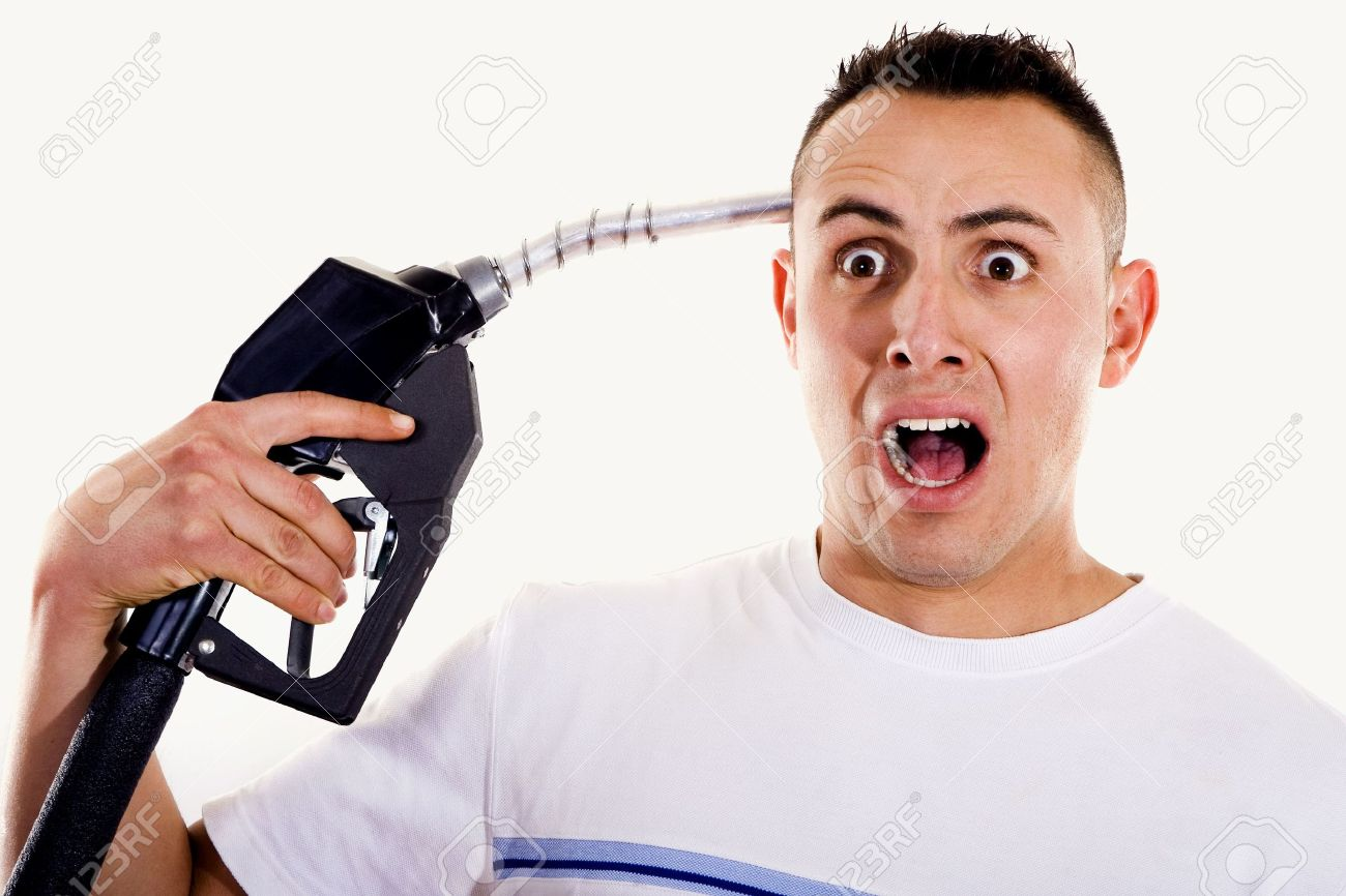 Stock Photo - Stock image of man shouting and pointing a fuel pump nozzle at his head - 6723562-Stock-image-of-man-shouting-and-pointing-a-fuel-pump-nozzle-at-his-head-Stock-Photo