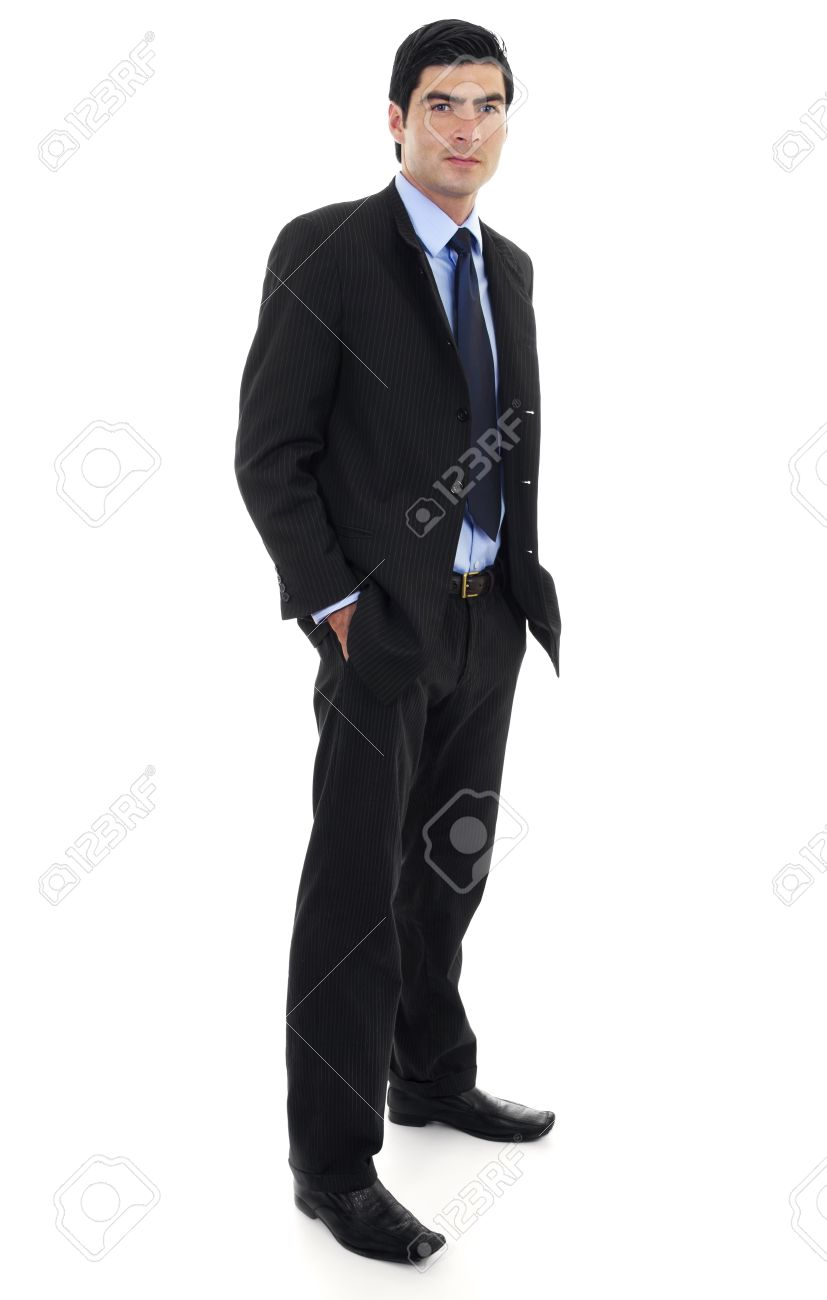 Stock image of businessman standing with arms on pockets over white background. Full body shot. - 7391201