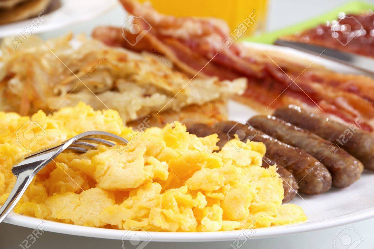 Stock image of hearty breakfast, focus on foreground. Stock Photo - 7860661